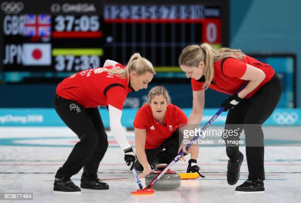 Great Britain's Vicki Adams watches as Anna Sloan and Lauren Gray sweep during the Women's Bronze Medal match at the Gangneung Curling Centre during...