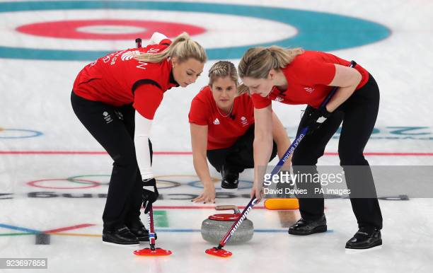Great Britain's Vicki Adams watches as Lauren Gray and Anna Sloan sweep during the Women's Bronze Medal match at the Gangneung Curling Centre during...