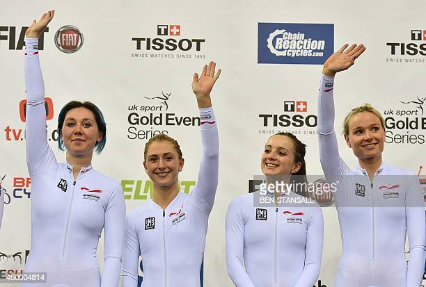 Great Britain's Women's Pursuit team Kate Archibald Laura Trott Elinor Barker and Ciara Horne celebrate after winning their event during the UCI...