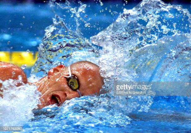 Great Britian's Graeme Smith powers through the water in the men's 1500metre freestyle final 29 July 2001 during the 9th FINA World Swimming...