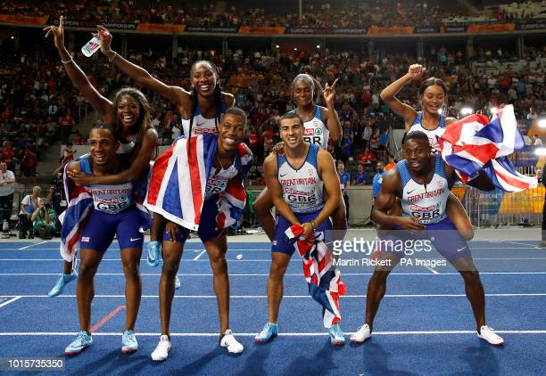 Great Britian's mens and womens relay teams celebrate during day six of the 2018 European Athletics Championships at the Olympic Stadium Berlin