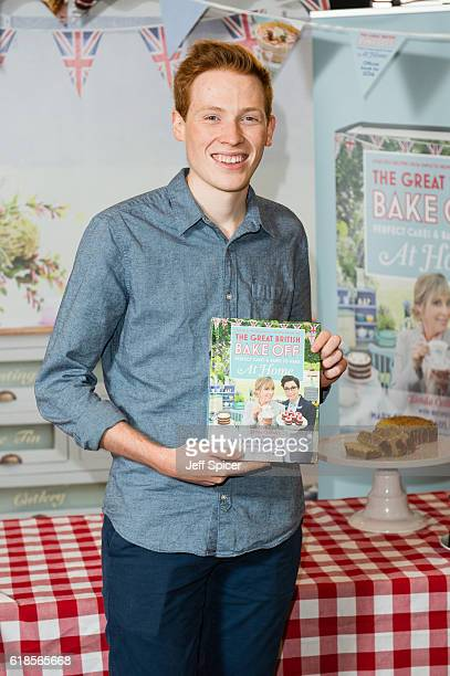 Great British Bake Off finalist Andrew Smyth signs copies of 'The Great British Bake Off Perfect Cakes Bakes to Make at Home' at Waterstones...