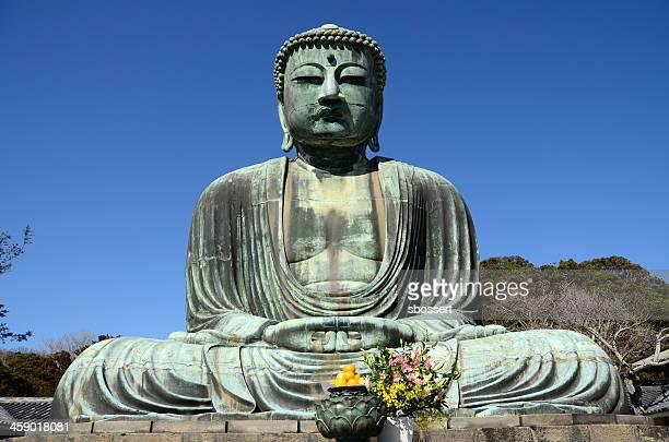 great buddha of kamakira - lotuspositie stockfoto's en -beelden