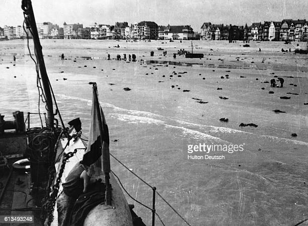 Great coats and military equipment litter the beach at Dunkirk after the famous evacuation of Allied troops to Britain during World War II The men...