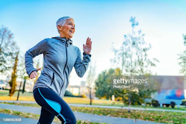 great day for a run - mature women stock pictures, royalty-free photos & images