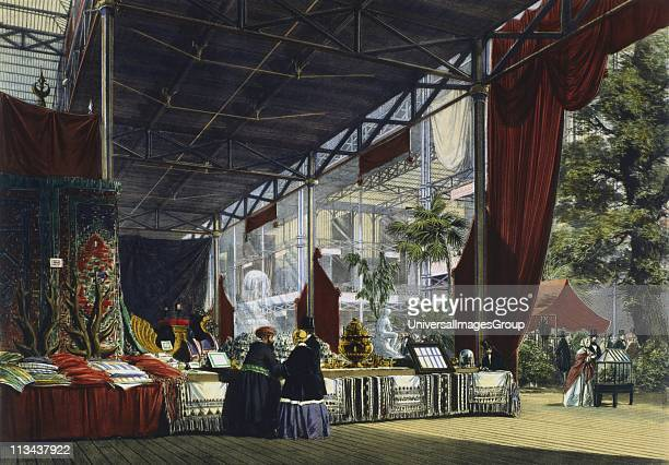 Great Exhibition Hyde Park London 1851 Interior view of the Crystal Palace showing two visitors being shown a stand of oriental products In the right...