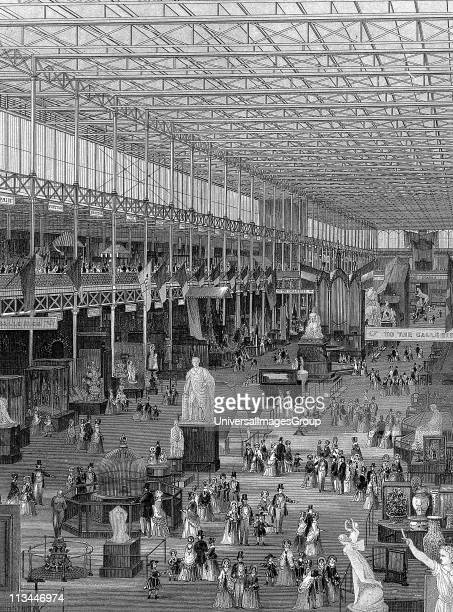 Great Exhibition of 1851 Crystal Palace Hyde Park London Interior view of main avenue looking east showing galleries supported by iron columns rising...
