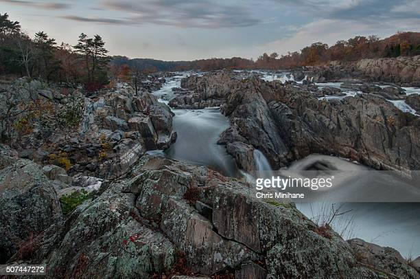 great falls virginia waterfall with rocks in foreground. - fairfax county virginia stock photos and pictures
