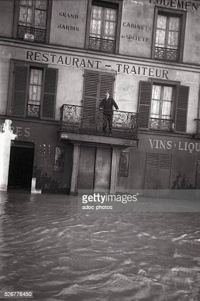 Great Flood of Paris A man at his balcony 136 quai d'Auteuil in Paris On January 24 1910