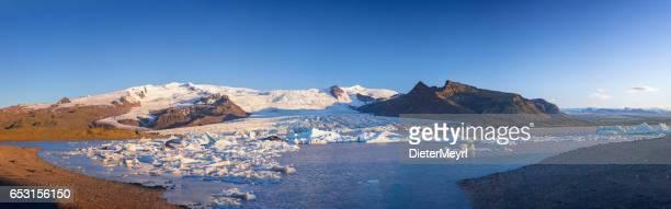 Great glacier lagoon in Iceland - Fjallsarlon at blue sky