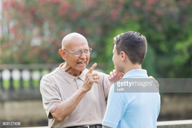 Great grandfather giving advice to teenager