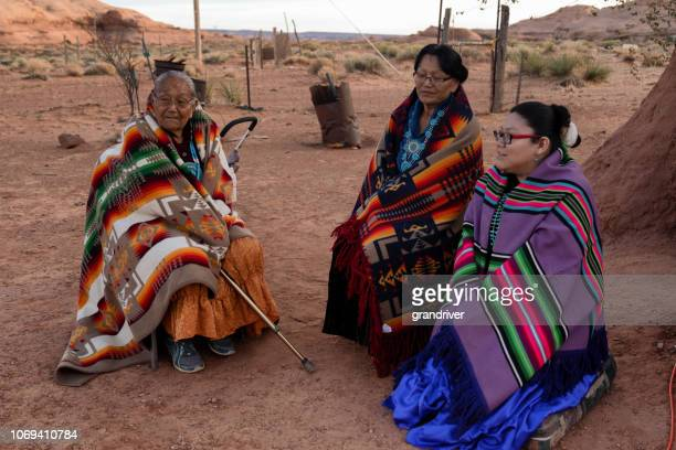 great grandma, grandmother and granddaughter, navajo women at monument valley - apache stock pictures, royalty-free photos & images