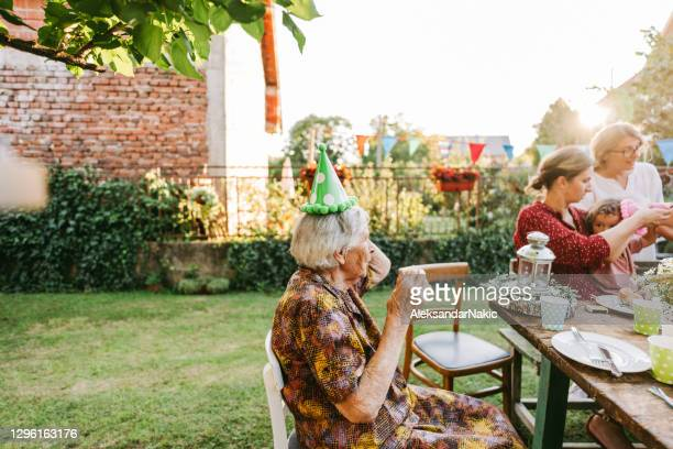 great grandma's birthday party - birthday stock pictures, royalty-free photos & images