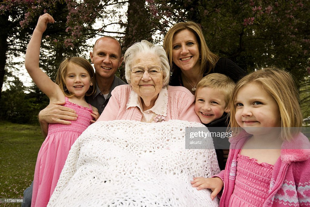 Great Grandmother and extended family children adults offspring outdoors : Stock Photo