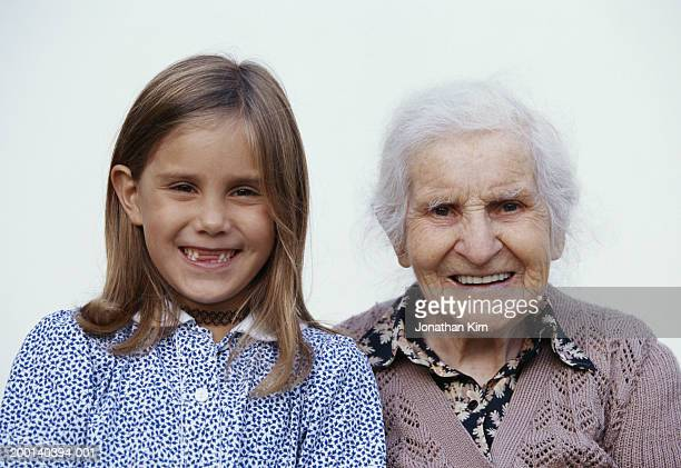 great grandmother and great granddaughter (6-8), portrait - great granddaughter stock photos and pictures