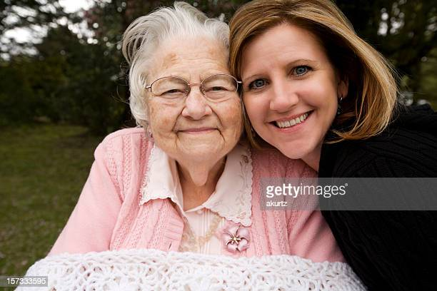 great grandmother and her granddaughter - great granddaughter stock photos and pictures