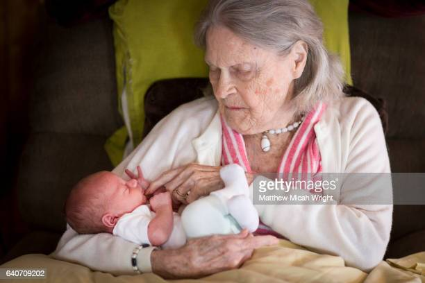a great grandmother holding a newborn great grandkid. - コスタメサ ストックフォトと画像