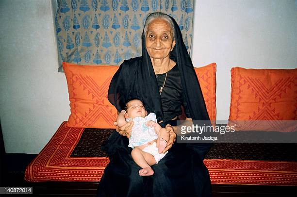 great grandmother holding her great grandson - gujarat stock pictures, royalty-free photos & images