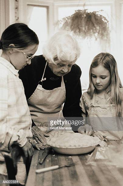 Great Grandmother Teaches Girls to Bake