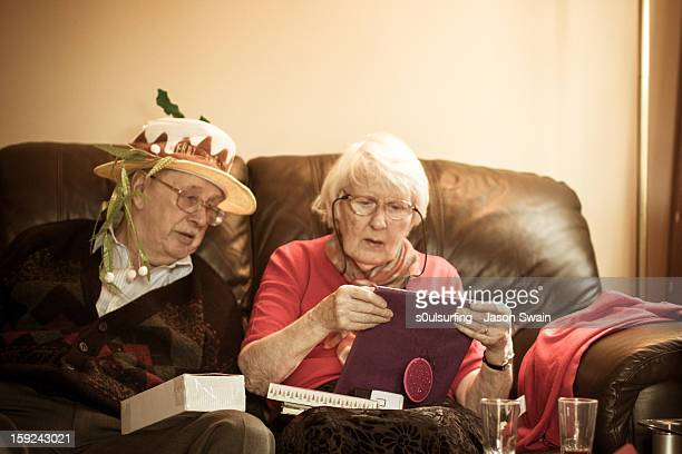 great grandparents at christmas - s0ulsurfing stock pictures, royalty-free photos & images