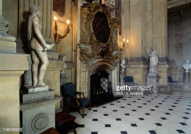 Great Hall, with fireplace and statues, inside Castle Howard, 1699-1799, designed by John Vanbrugh , York, England, United Kingdom.