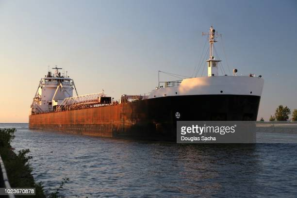 great lakes iron ore boat supplies american steel industry with mined taconite pellets approaches the harbor - naval station great lakes stock pictures, royalty-free photos & images