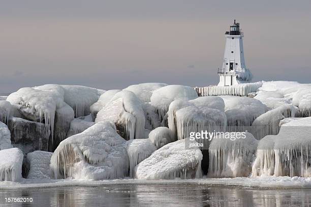 Great Lakes Lighthouse with ice covered rocks in foreground