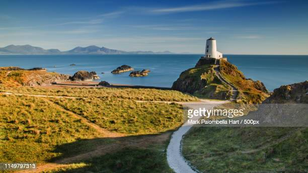 great lighthouse tower - caernarfon stock pictures, royalty-free photos & images