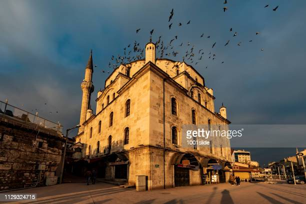 great mosque, flying pigeons and photographers shadows - bolu city stock photos and pictures