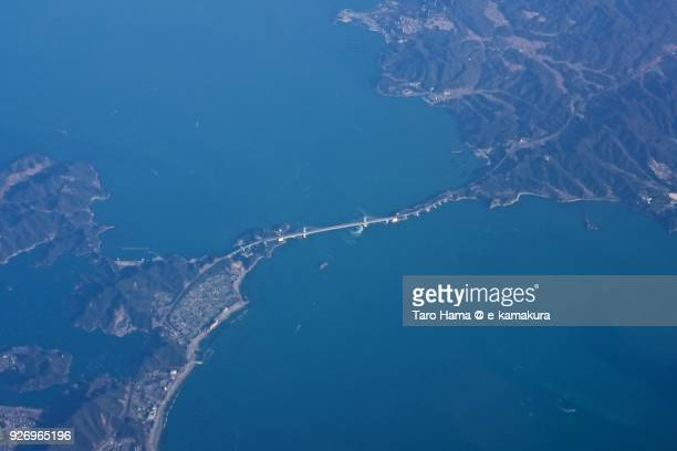 Great Naruto Bridge (Onaruto Bridge) and Naruto Strait in Naruto city in Tokushima prefecture in Japan daytime aerial view from airplane