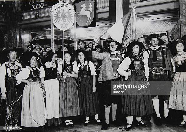 Great national costume party with a Tyrolean delegation in the rooms at the Zoo in Berlin. September 1931. Photograph.