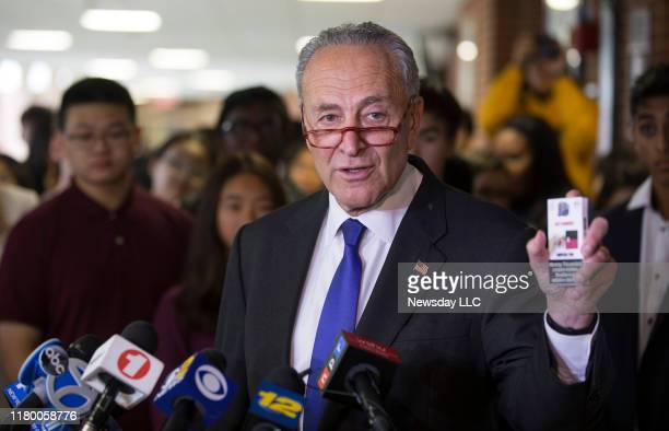 Senator Chuck Schumer speaks to members of the media at William A Shine Great Neck South High School in Great Neck New York on October 8 about the...