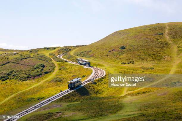 great orme tramway moving across picturesque hills, llandudno, wales - llandudno wales stock pictures, royalty-free photos & images