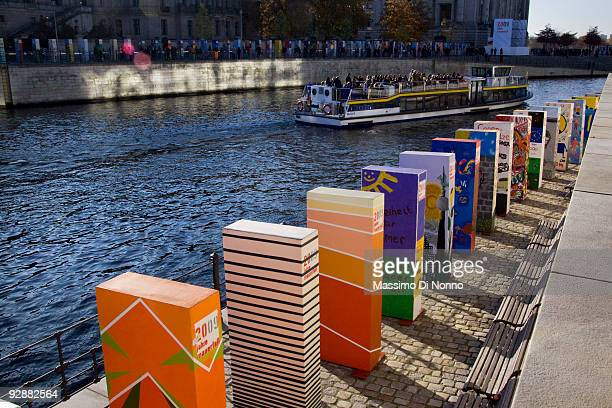 Great painting domino on the Spree river near the Reichstag on November 7 2009 in Berlin Germany The dominoes which will be tipped over to symbolize...
