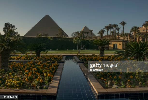great pyramids of giza as seen from the mena house in giza, egypt in northern africa - pyramid shapes around the house stock pictures, royalty-free photos & images
