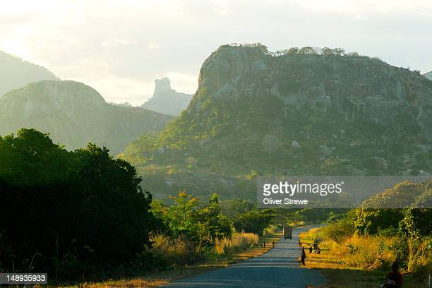 great rock formations litter the drive from nampula to pemba, mozambique - mozambique stock pictures, royalty-free photos & images