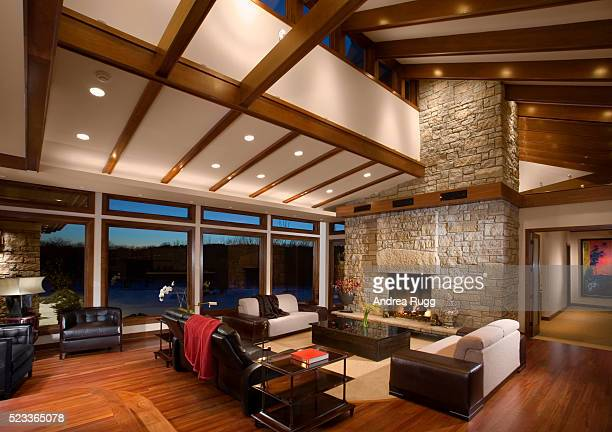 great room with stone fireplace - ceiling stock pictures, royalty-free photos & images