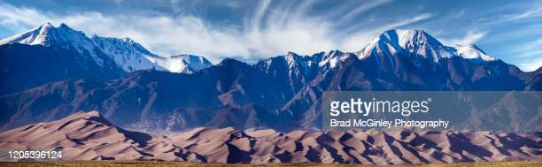 great sand dunes national park piano with mountains - great sand dunes national park stock pictures, royalty-free photos & images