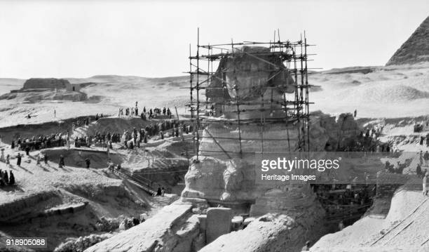 Great Sphinx of Giza Egypt 1931 The head of the sphinx is encased in scaffolding and works are under way excavating the body Artist Unknown