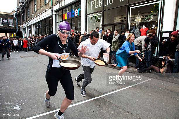 Great Spitalfields Pancake Race on Shrove Tuesday, pancake day, at the Old Truman Brewery, London, UK. This is a fun quirky annual event where...