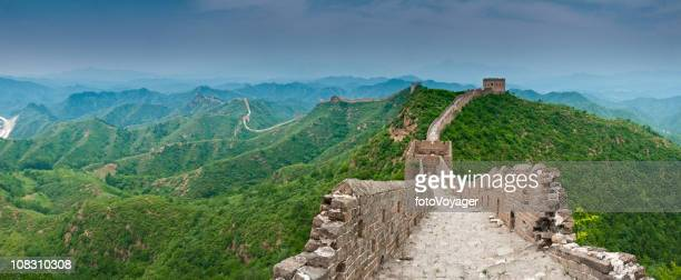 great wall china dramatic sky green mountain ridges watchtowers panorama - wide angle stock pictures, royalty-free photos & images