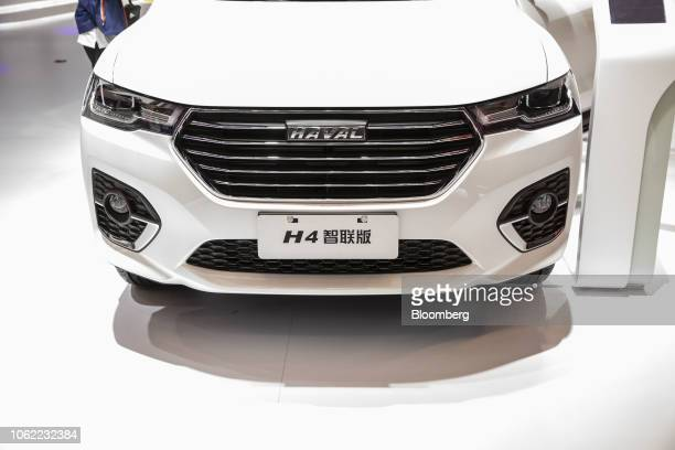 Great Wall Motor Co's Haval H4 sport utility vehicle is displayed at the Guangzhou International Automobile Exhibition in Guangzhou China on Friday...