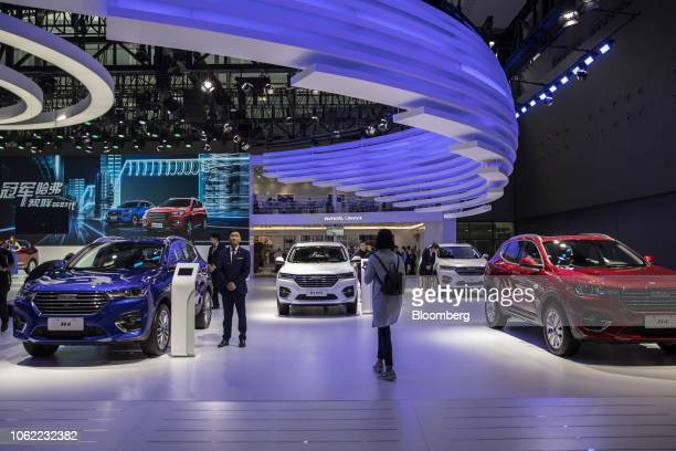 Great Wall Motor Co's Haval H4 sport utility vehicles are displayed at the Guangzhou International Automobile Exhibition in Guangzhou China on Friday...