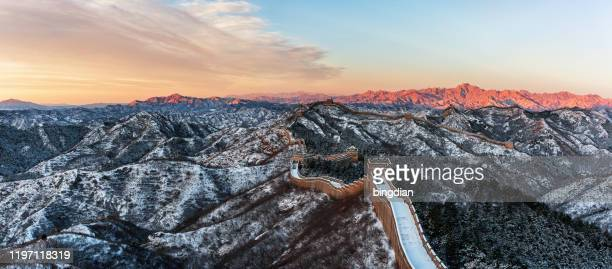 great wall of china covered with snow - unesco world heritage site stock pictures, royalty-free photos & images