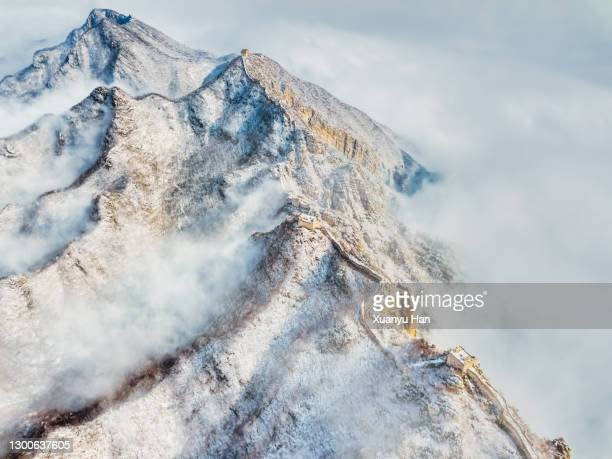 great wall of china in winter - extreme terrain stock pictures, royalty-free photos & images