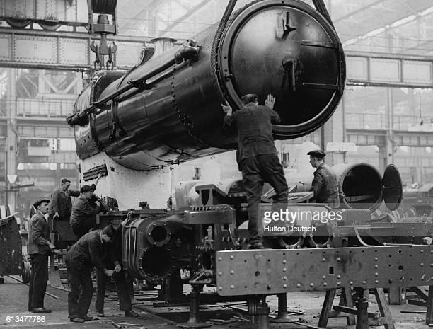 Great Western Railway engineers at work on a steam locomotive