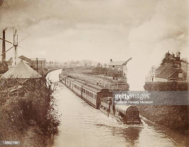 Great Western Railway passenger train travelling down a flooded track at Creech Cutting Devon 1894 Water from the nearby river had flooded the line...