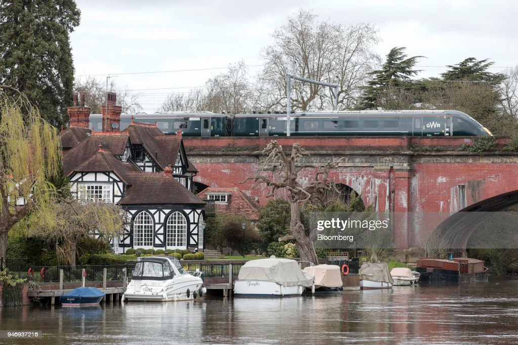 A Great Western Railway train, operated by FirstGroup Plc, crosses the River Thames on the Maidenhead Railway Bridge near Maidenhead, U.K., on Monday, April 16, 2018. British train and bus operator FirstGroup Plc said it rejected an 'opportunistic' takeover proposal that private-equity firm Apollo Management made as the company struggles with under-performing rail routes in the U.K. and competition from discount airlines in the U.S. Photographer: Jason Alden/Bloomberg via Getty Images
