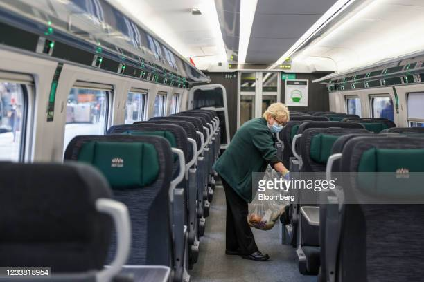 Great Western Railway worker cleans a train, operated by FirstGroup Plc, at London Paddington railway station in London, U.K., on Monday, July 5,...