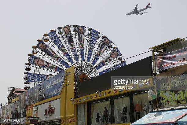 TOPSHOT A great wheel in the Lebanese capital Beirut carries electoral billboards of Lebanese Prime Minister and candidate for the upcoming...